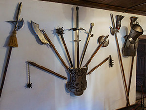 Cold weaponry displayed on the wall of Bran Castle, also known as Dracula Castle, in Transylvania, Romania, photo by Ivan Kralj