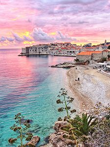 The colorful sunset over the turquoise Bane Beach and fort walls of Dubrovnik, Croatia, received more than 20.000 likes on the official Instagram account of Croatian National Tourist Board, making it the second most liked image in 2017, photo by Ivan Kralj