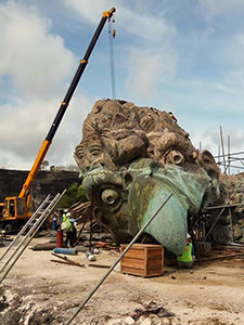 Garuda's head at the working site, several times bigger than the human worker, when assembled at GWK Cultural Park in Bali, Indonesia, this will be one of the largest sculptures in the world