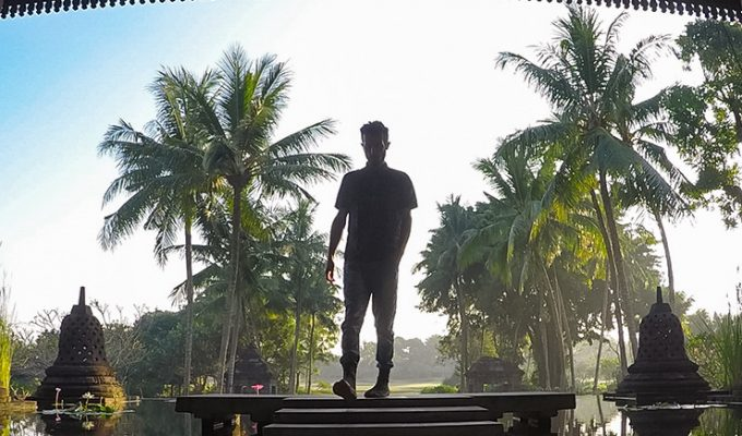 The silhouette of Pipeaway blogger Ivan Kralj with palms in the background at Hyatt Regency Yogyakarta, Java, Indonesia, photo by Ivan Kralj