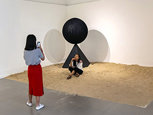 Two girls interacting with the exhibits in Galeri Nasional Indoensia, while taking selfies, in Jakarta, Indonesia, photo by Ivan Kralj