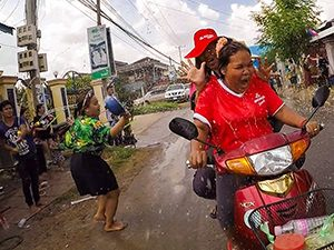 Action-style photo of people splashing the two ladies on a scooter with water, during the Khmer New Year celebration in Battambang, Cambodia. The photograph by Ivan Kralj made it to the selection of the best travel photos of the year 2017 at Fotorama's art photography festival in Kragujevac, Serbia