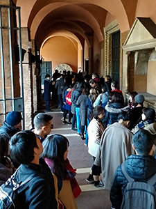 People queuing for Bocca della Verita, Mouth of Truth, to take a picture with a scuplture that supposedly bites off the liar's hand, Basilica of Santa Maria in Cosmedin, Rome, Italy, photo by Ivan Kralj