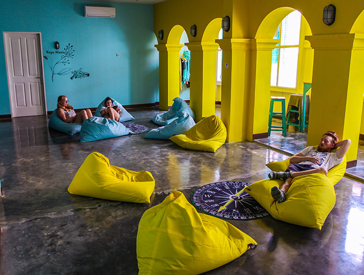 Guests resting on the blue and yellow beanbags in the lounge of Wonderloft hostel in Jakarta, Indonesia, photo by Ivan Kralj