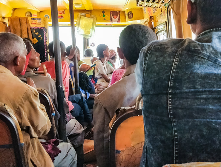 Passengers sitting in the overcrowded African local bus, traveling from Bahir Dar to Tis Abay in Ethiopia, photo by Ivan Kralj
