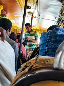 Bus conductor selling tickets in the African local bus from Bahir Dar to Tis Abay, Ethiopia, photo by Ivan Kralj