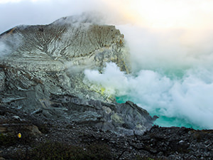 Sulfur smokes above the acidic crater lake of Kawah Ijen Volcano, East Java, Indonesia, photo by Ivan Kralj