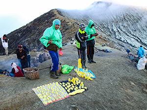 Miners selling figurines made of sulfur excavated at Kawah Ijen Volcano, East Java, Indonesia, photo by Ivan Kralj