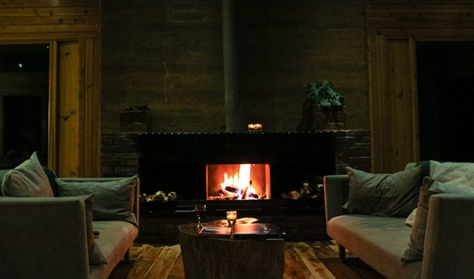 Fireplace with cozy sofas in the bar area of Limalimo Lodge at Simien Mountains, Ethiopia, photo by Ivan Kralj