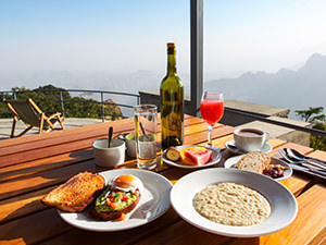 Rich breakfast served on the terrace of Limalimo Lodge with stunning views of Simien Mountains, photo by Ivan Kralj
