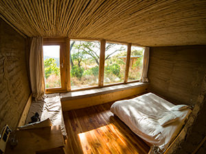 Interior of the room in Limalimo Lodge at Simien Mountains, Ethiopia, with massive windows looking into nature, photo by Ivan Kralj