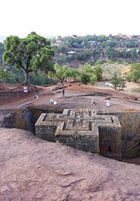 Bete Giyorgis in Lalibela, Ethiopia, rock-hewn church in the shape of the Greek cross, with pilgrims praying around the site, photo by Ivan Kralj