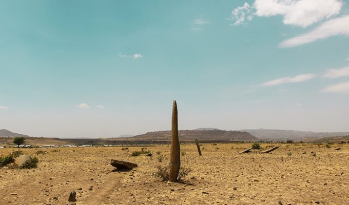 One of the monoliths standing in the desert surrounding of Gudit Stelae Field in Aksum, Ethiopia, photo by Ivan Kralj