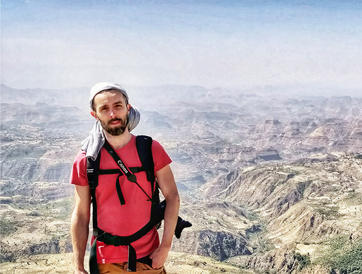 Pipeaway blogger Ivan Kralj standing in front of the landscape of Simien Mountains in Ethiopia, Africa