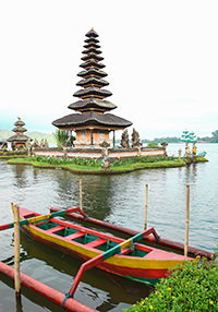 Pura Ulun Danu Beratan temple pagoda on lake in Bali, Indonesia, reachable only by the traditional boat in front, photo by Ivan Kralj