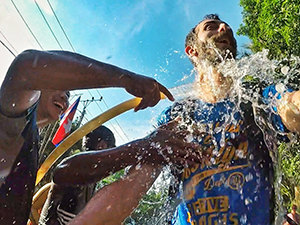 Pipeaway blogger Ivan Kralj getting splashed with water during the bike ride in Battambang, Cambodia, on the occasion of Khmer New Year - Songkran water festival, photo by Ivan Kralj