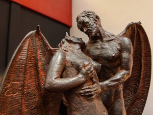 Sculpture of a winged devil holding a naked woman in his arms, displayed at Devil's Museum in Kaunas, Lithuania, photo by Ivan Kralj