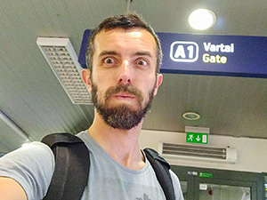 Blogger Ivan Kralj making the face of relief after making it to the gate at Vilnius Airport only 20 minutes after waking up - tiredness connected to travel fogginess experiences takes its toll, photo by Ivan Kralj