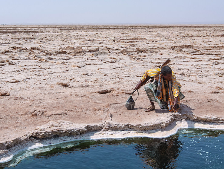 Afar man at the edge of the little lake in Danakil Depression, Ethiopia, the hottest place on Earth, photo by Ivan Kralj