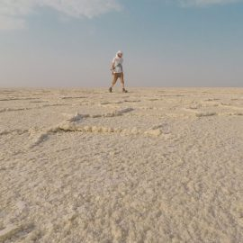 Pipeaway blogger Ivan Kralj walking over the salt plains of Lake Assale, Danakil Depression, Ethiopia, the hottest place on Earth, photo by Ivan Kralj