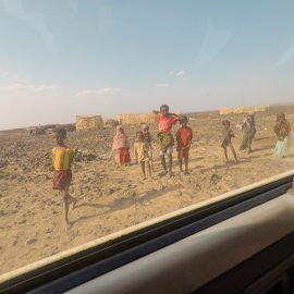 Local children in the desert, as seen from the car, in Danakil Depression, Ethiopia, the hottest place on Earth, photo by Ivan Kralj