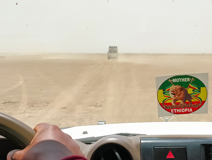 Driving through the dusty desert in Toyota Land Rovers, in Danakil Depression, Ethiopia, the hottest place on Earth, photo by Ivan Kralj