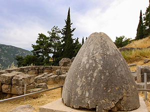 Omphalos, or religious stone marking the center of the world according to Greek mythology, dropped by the eagles sent by Zeus from west and east - they met at Delphi, Greece, photo by Ivan Kralj