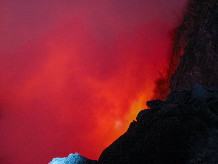 One of the world's five permanent lava lakes hiding under the cloud of smoke, at Erta Ale volcano in Danakil Depression, Ethiopia, the hottest place on Earth, photo by Ivan Kralj