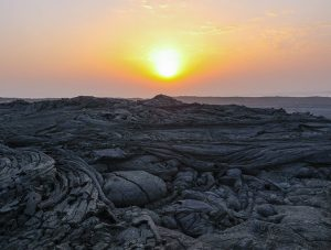 Sunrise above the solidified lava rock at Erta Ale volcano in Danakil Depression, Ethiopia, the hottest place on Earth, photo by Ivan Kralj
