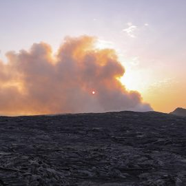Sunrise behind the smoke of Erta Ale volcano in Danakil Depression, Ethiopia, the hottest place on Earth, photo by Ivan Kralj