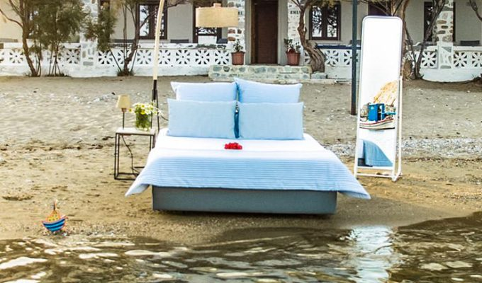 Bed set for sleeping placed on the Achladi Beach in Syros, in front of the Hotel Emily, one of the best beachfront hotels in Cyclades Islands, Greece