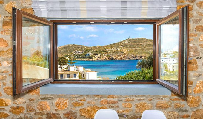 Turquoise Aegean Sea at Achladi Beach as seen through the window of Syra Suites in Syros, Greece, copyright Syros Suites