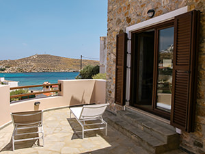 Sea view from the sunbeds at the terrace of one of Syra Suites, on Syros island, Greece, photo by Ivan Kralj