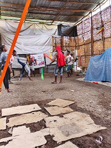 Bare earth ground covered with cardboard in the training hall of Arba Minch Circcus, the social circus group in Ethiopia, photo by Ivan Kralj