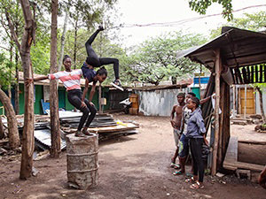 Girls training partnered contortion on the barrel in the courtyard of Arba Minch Circus, Ethiopia, photo by Ivan Kralj