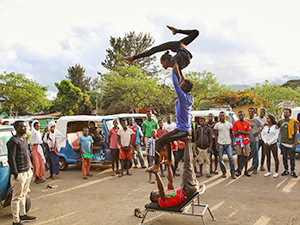 A group of acrobats from Arba Minch Circus pulls of for an impromptu street performance in Arba Minch, Ethiopia, while the crowd gathers around them, photo by Ivan Kralj