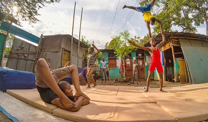 Street kids training contortion and acrobatics in the courtyard of Arba Minch Circus, social circus in Ethiopia, photo by Ivan Kralj