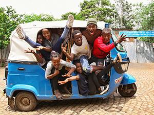 Eight members of the Arba Minch Circus, Ethiopia, squeezed in one bajaj, photo by Ivan Kralj