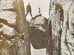 Old photograph of people posing on Kjeragbolten, a famous boulder on Kjerag Mountain, Norway, photo by Ivan Kralj