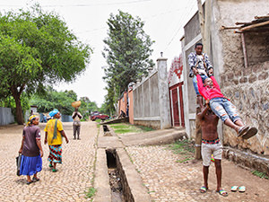 "One of the ""Circus of Postcards"" postcards: Arba Minch Circus acrobats performing in the street of Arba Minch, Ethiopia, while the surprises passers-by watch, photo by Ivan Kralj"