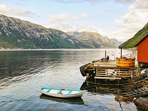 A boat in the Lysefjord and hot tub at the dock of Flørli 4444, home to the longest staircase in the world, photo by Ivan Kralj