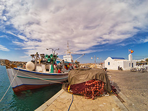 Fishermen boat and nets in front of the Church Agios Nikolaos in Naoussa, Paros, Greece, photo by Ivan Kralj