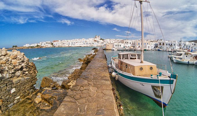 Dock connecting the old harbor of Naoussa and Venetian Castle is a splashing attraction, and one of the top ten things to do in Naoussa, Paros, Greece, photo by Ivan Kralj