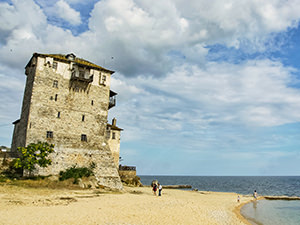 Byzantine Tower of Prosphorio on the beach of Ouranoupoli, the ferry port for visiting Mount Athos monasteries on the Holy Mountain, Greece, photo by Ivan Kralj