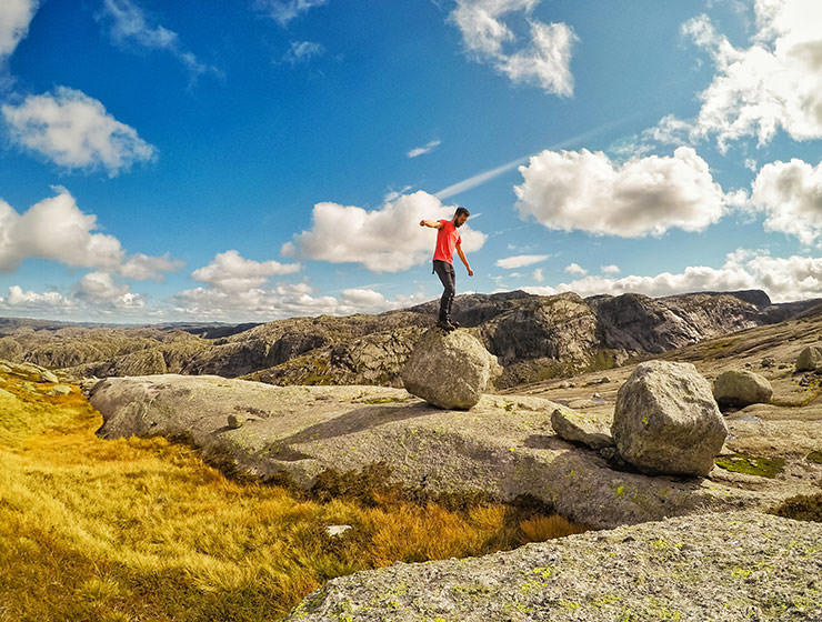 Pipeaway blogger Ivan Kralj balancing on the boulder in Kjerag mountain, Norway, photo by Ivan Kralj