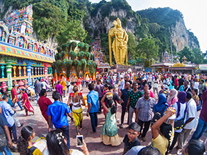 Pilgrims and tourists flocking to Batu Caves, the place of Thaipusam Festival 2019, celebrating Lord Murugan whose enormous golden statue stands just next to the 272 stairs leading to the cave temples, photo by Ivan Kralj