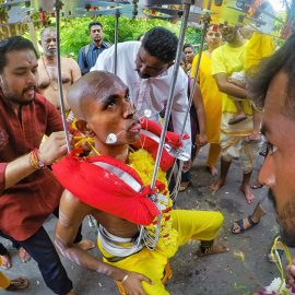 Prakash J Govindarajoo family piercing him as a preparation for Thaipusam Festival 2019, his tongue and cheeks are pierced with spike, photo by Ivan Kralj