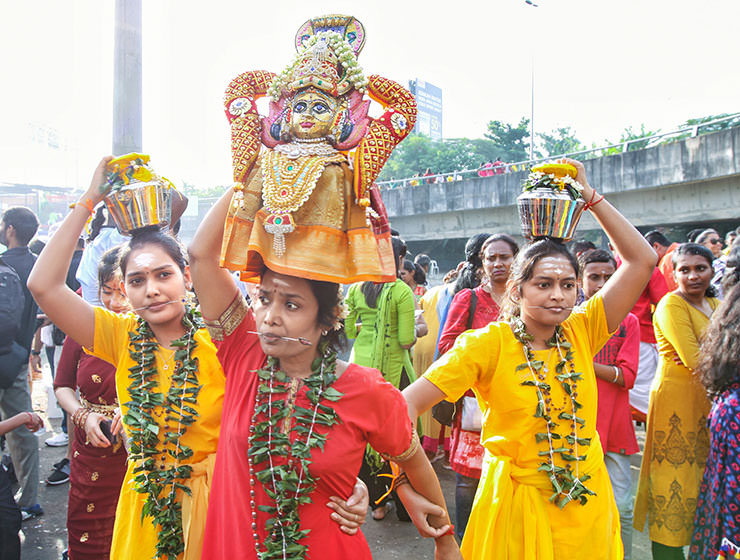 Three female devotees with pierced tongues, carrying paal kudam at Thaipusam Festival 2019 at Batu Caves, Malaysia, photo by Ivan Kralj