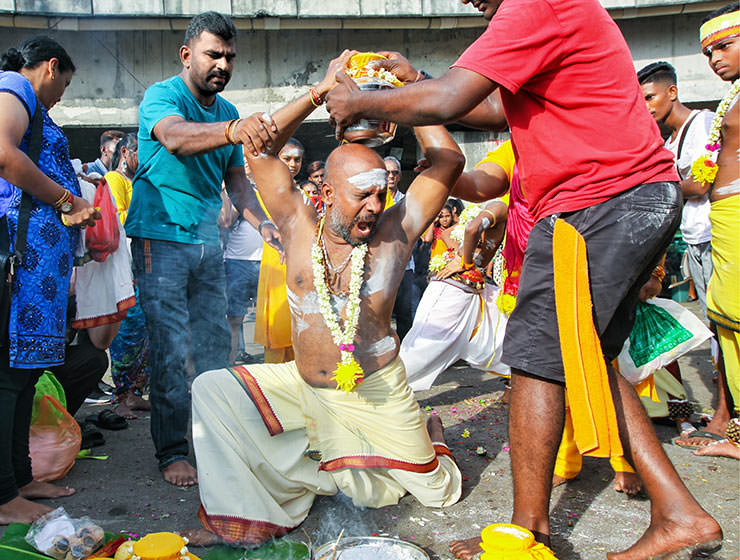 Devotee screaming while putting paal kudam milk pot on his head, at Thaipusam Festival 2019 at Batu Caves, Malaysia, photo by Ivan Kralj