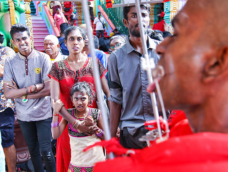 Shocked onlookers watching the pierced devotee passing by at Thaipusam Festival 2019 at Batu Caves, Malaysia, photo by Ivan Kralj